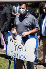 District Attorney Daryl Bailey supports MPD officer Carlos Taylor is joined by family and friends during a car parade in his honor in Montgomery, Ala., on Thursday, May 14, 2020. Taylor was injured in a crash while on duty in 2017.