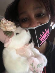 Kimyatta Moss holds a Mother's Day gift she got May 8 while in quarantine.