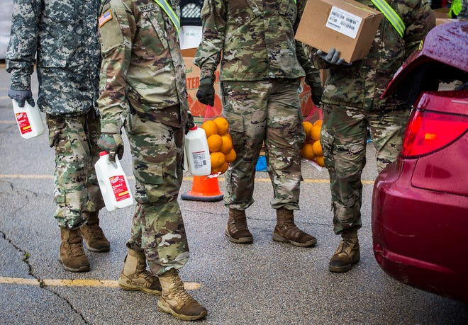 Second Harvest and the Indiana National Guard load more than 400 cars with meals in the Muncie Mall parking lot Thursday, May 14, 2020. The food bank and other local agencies have stepped up to answer community needs during the coronavirus pandemic.