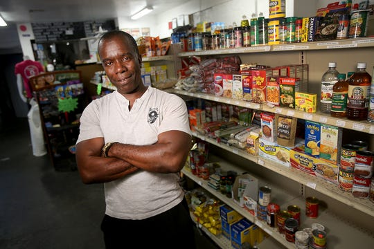 Burnell Cotlon inside his Burnell's Lower 9 Market on Sunday, May 10, 2020.