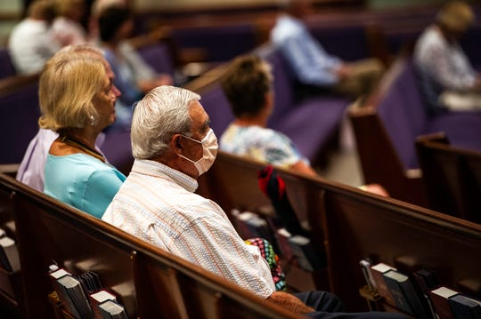 Church goers use social distancing protocols during an early morning service at First Presbyterian Church in Bonita Springs on Sunday, May 10, 2020. First Presbyterian Church is one of the first to start opening its sanctuary for services, under the rationale that it has less than 25% of its winter congregation here during the summer and social distancing would be easy.