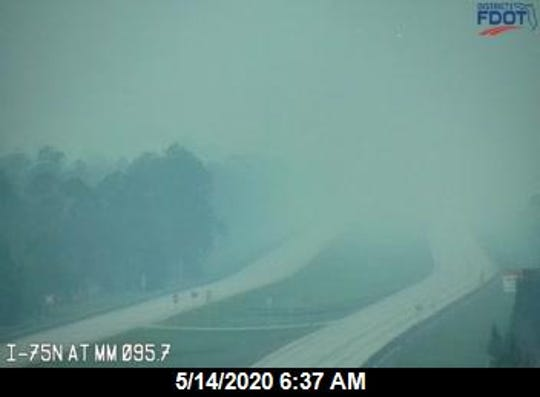 Smoke from a brush fire near I-75 in Collier County east of Collier Boulevard. This portion of the interstate has been closed due to the conditions and a detour set in place.