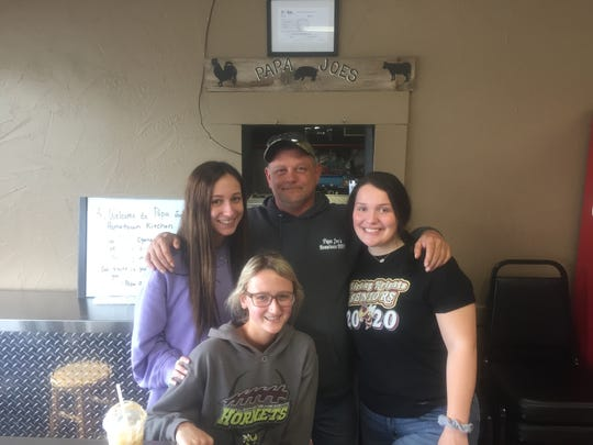 Papa Joe's Joel Lively with staff members (from left) Abby Amrine, Haille Shearer and Janie Coulter.