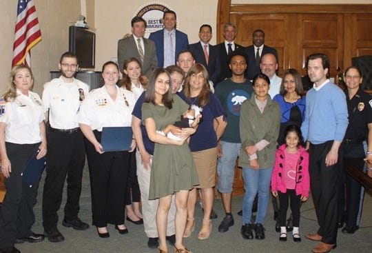 Bergenfield resident holding her baby daughter that Bergenfield police officers and other first responders helped deliver in March 2018.