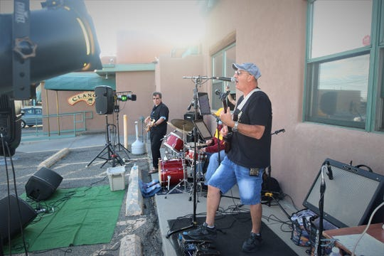 Jose Villareal leads his band through a performance during the opening night of the Sunset Curbside Concert Series on May 13, 2020, at Clancy's Irish Cantina.