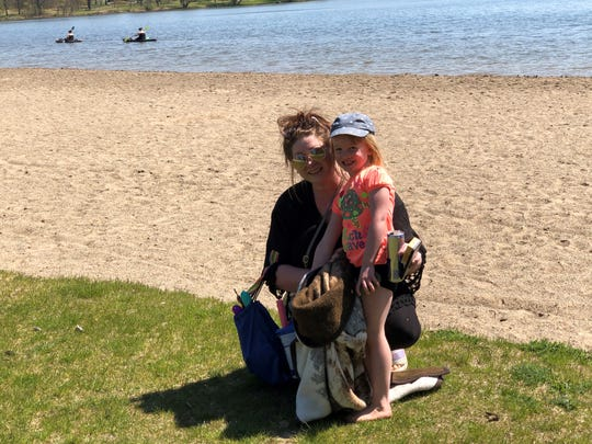 Angela Smith of Fowlerville, with daughter Delilah, 4, at Kensington Metropark on May 13, 2020.