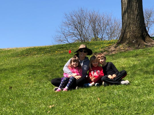 Colleen Carstens of Milford with her twin daughters, Shea and Mave, 4, and son, Ronan, 7, at Kensington Metropark on May 13, 2020.