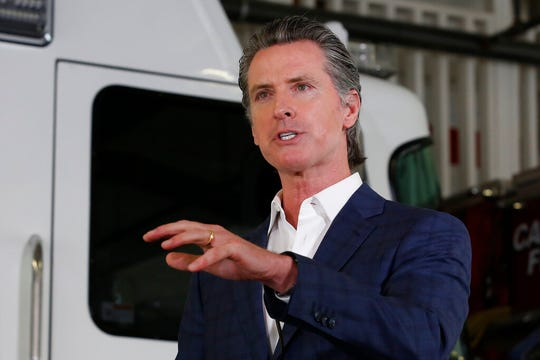 Gov. Gavin Newsom discusses his revised state budget proposal during a news conference at the CalFire/Cameron Park Fire Station in Cameron Park, Calif., Wednesday, May 13, 2020. (AP Photo/Rich Pedroncelli, Pool)