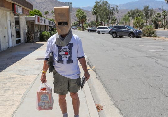 Steve Gannon did his shopping with his modified face covering in Palm Desert, May 13, 2020.