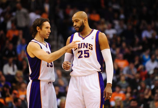 Steve Nash (13) and Vince Carter (25) were teammates in Phoenix for a season.