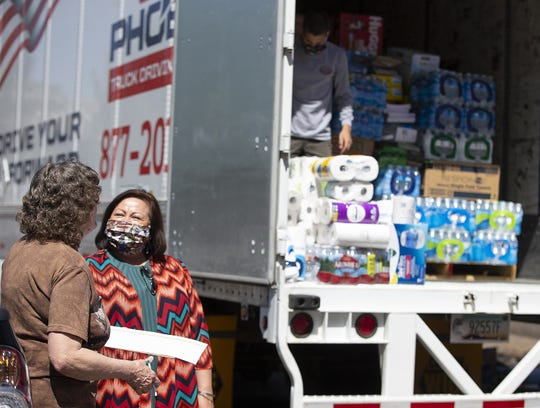 Rosemary Olson, of Phoenix, left, speaks with Patricia Hibbeler, Phoenix Indian Center CEO, after she dropped off some donations for the COVID-19 relief to the Navajo Nation.