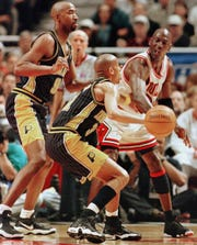 CHICAGO, UNITED STATES:  Derrick McKey (L) and Reggie Miller (C) of the Indiana Pacers try to guard Michael Jordan (R) of the Chicago Bulls 31 May during the first half of game seven of their NBA Eastern Conference finals game at the United Center in Chicago, IL. The winner of this series will take on the Utah Jazz in the NBA finals staring 03 June.   AFP PHOTO/Jeff HAYNES (Photo credit should read JEFF HAYNES/AFP via Getty Images)