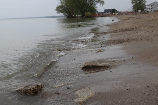 Incessant erosion displacing large amounts of sand has pieces of debris from a 1930s road project washing ashore at Port Clinton's city beach.