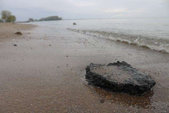 Incessant erosion displacing large amounts of sand has resulted in debris from a 1930s road project washing ashore at Port Clinton's city beach.