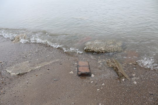 In the 1930s a portion of Perry Street was rerouted and pieces of the old road were buried in sand at Port Clinton's city beach. Now those pieces of road are washing ashore due to incessant erosion.
