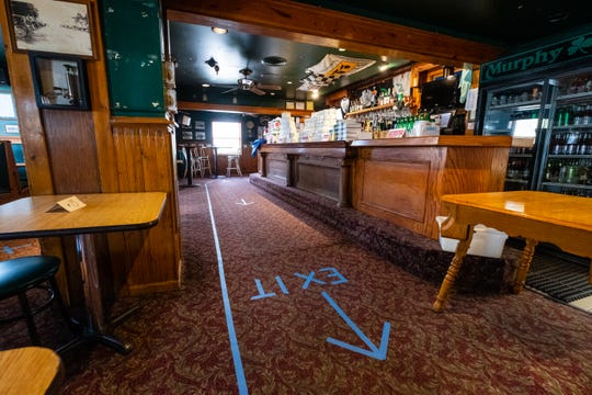 The floor at Murphy Inn has been marked to enforece one-way traffic through the restaurant to help maintain social distancing.