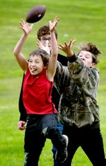 The Stough children, from left, Hunter, 8; Skylar, 15, and Audrey, 12, vie for a catch while playing with their father Richard at Codorus State Park Thursday, May 14, 2020. Richard said it was important for the kids to get some exercise. Bill Kalina photo