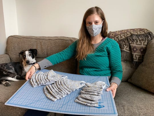 Dallastown High grad Jenna Sher is a set designer for commercial and music videos, living with her husband in Brooklyn, N.Y. Since the novel coronavirus hit New York City so hard, Jenna, pregnant with her first child, has been making masks to help others. Her dog Juniper keeps an eye on the process.