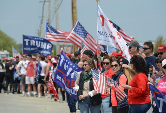 A group of Trump supporters gather across the street from a facility the President was touring  Thursday, May 14, 2020 in Uper Macungie. The parade was put together by the local community with the help of a former elementary school teacher. (WILLIAM THOMAS CAIN/PHOTOJOURNALIST)