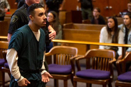 Juan Rodriguez-Palacios, 26, is taken out of the courtroom after receiving a 300-month sentence at the Marion County Circuit Courthouse in Salem on May 14, 2020.