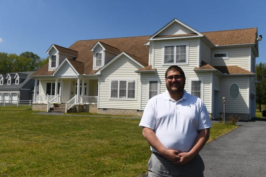 Joe Wilson, Coastal Association of Realtors president, stands near a property for sale in Berlin, Maryland, on May 13, 2020.