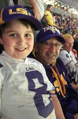 LSU fan Parker Suckle (left) and Mickey Spagnola of DallasCowboys.com take in LSU's victory at the 2020 National Championship Game in New Orleans.