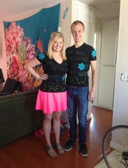 "Brad and Megan Hoelscher smile for a photo before their first appearance on ""The Price is Right"" in August of 2014."