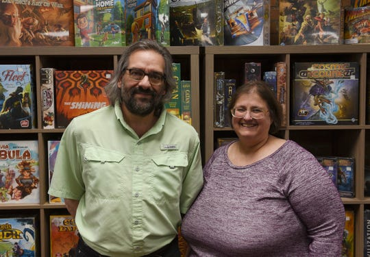 Paddy's Game Shoppe owners Gino and Dawn Marinaro pose for a picture Thursday, May 14, 2020, in St. Cloud. They began doing online ordering and curbside pickup last week and will re-open on Monday.