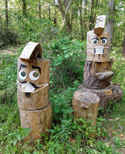 """Ann Dunan's """"Woody and Pecker"""" timber sculptures  depict two masked woodland creatures."""