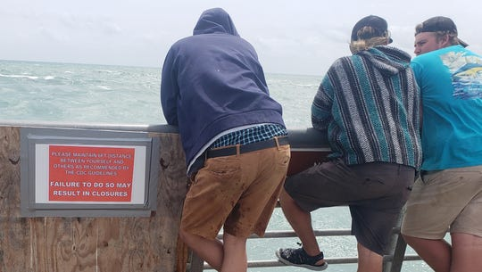 Six feet apart is treated as a suggestion by some anglers at Sebastian Inlet State Park on May 14, 2020.