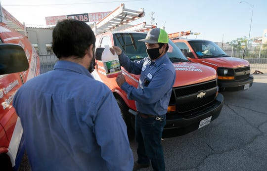 Rudy Fierro, right, and Daniel Torres of Mechanical Technologies prepare to head out on service calls Thursday from their central El Paso facility.