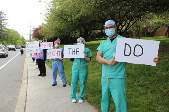 Health care workers gather at Good Samaritan Hospital in Suffern May 14, 2020. The workers are looking for hazard pay for their work during the unprecedented COVID-19 pandemic.