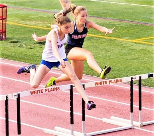 Pearl River's Allie Ritchie (l), shown here clearing hurdle, will compete next year for Springfield College in Massachusetts. (Submitted photo)