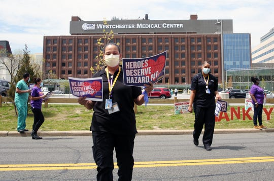 Belkis Cartwright and other Westchester Medical Center workers hold a silent vigil outside the medical center in Valhalla May 14, 2020. The workers are still looking for any form of hazard pay for their work during the unprecedented COVID-19 pandemic.