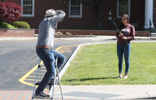 Chad Kraus photographing Pleasantville High School seniors on the front lawn of the high school May 13, 2020. Kraus, a local photographer donating his time and talent to the community, asked members of the Class of 2020 to come back to the high school with a memento that captured their senior year and, perhaps, the loss they've felt.