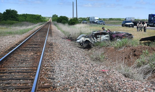 Department of Public Safety, Clay County Sheriff's Office and Burlington Northern Sante Fe Railroad work the scene of a fatality accident involving a train and a car Thursday morning. One man died in the accident.