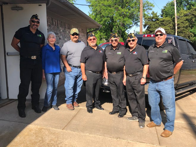 Pictured from left  are DAV member, Ty Howard; Camp Fire Executive Director Bettye Ricks, and DAV members, Scott Martinez, David Sapata, Joel Jimenez, Larry Main and Troy Melton. Camp Fire donated 131 cases of their candy to veterans in Oklahoma City.