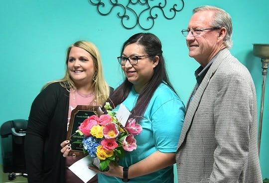 January Cadotte, left, and Lance Spruiell presented Adriana Avila with the 2019-2020 Dorothy Moser Huffman Award for Creative Teaching Thursday morning at Zundy Elementary.