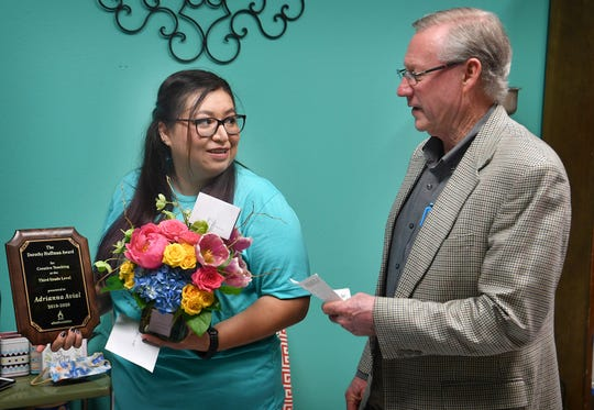Adriana Avila, a third grade teacher at Zundy Elementary, receives the 2019-2020 Dorothy Moser Huffman Award for Creative Teaching from Lance Spruiell, chair of the Wichita Falls ISD Foundation Board Thursday morning.