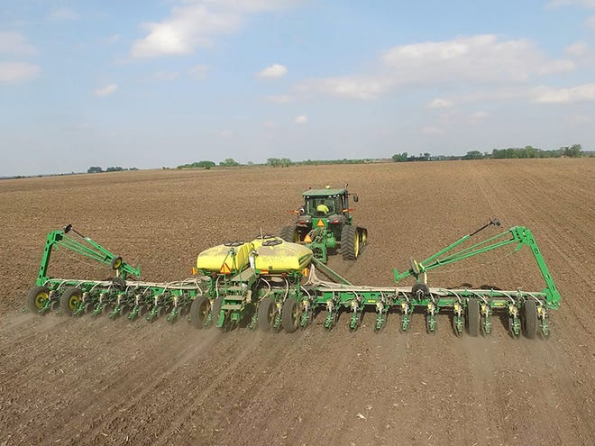 Large-scale machinery planting soybeans on a farm in Iowa – captured using a drone.