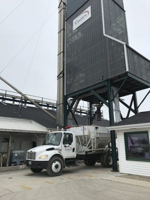 A load of fertilizer is dumped into an awaiting truck at the Country Visions Cooperative plant in Fond du Lac.