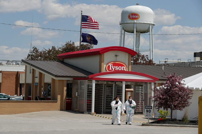 Workers leave the Tyson Foods pork processing plant in Logansport, Ind. Meat exports are surging this spring at the same time the processing industry is struggling to meet domestic demand as workers get sick with the coronavirus and companies scramble to make plants safer for employees.