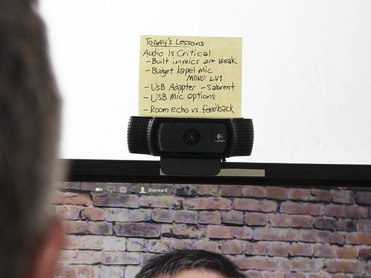 """Larry Becker, the author of """"Great on Camera"""" puts stick notes above his webcam to keep him on track and to make sure he's looking at the camera, not the screen"""