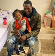 """""""I just hope and pray for the best,"""" says Detroit father Carlos Watkins on sending his 2-year-old son back to daycare when Michigan reopens."""