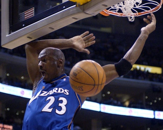 Washington Wizards' Michael Jordan follows through after a dunk against the Los Angeles Lakers during the first half Friday, March 28, 2003, in Los Angeles.