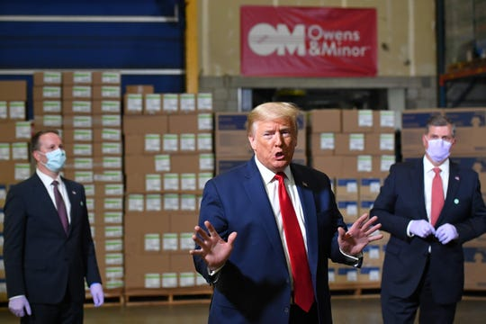 US President Donald Trump speaks as he tours an Owens & Minor, Inc., medical supplies distribution center in Allentown, Pennsylvania, on May 14, 2020.