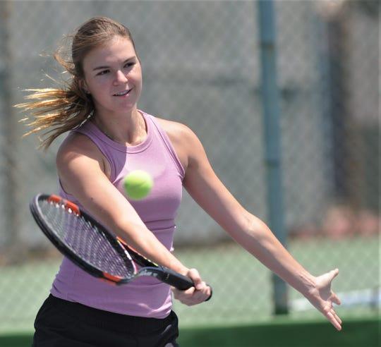 Abilene High senior Katherine Morris returns a shot during a private tennis lesson May 7 at Rose Park Tennis Center.