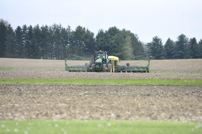 A farmer plants his crops Thursday evening just off Ohio 61 between Galion and Crestline near the Richland-Crawford county line.