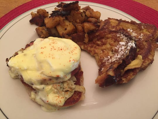 Eggs Benedict and Kahlua French toast from Sneakers Bistro in Winooski share a plate May 15, 2020.