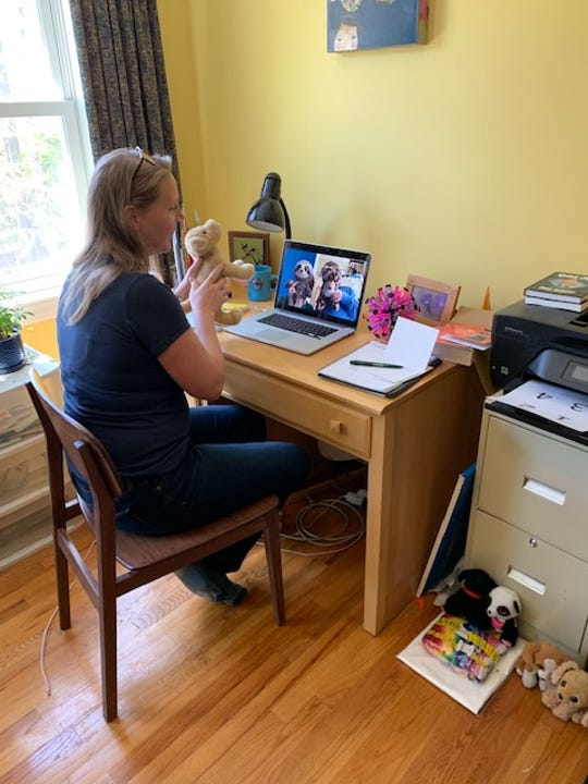 Kristin Mount, a clinician from Howard Center, uses telehealth technology with her colleagues. One of the challenges for clinicians has been conducting in-person counseling sessions, such as play therapy, to their younger clients.
